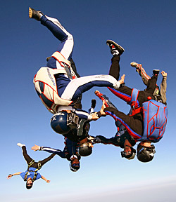 Experienced skydivers doing a head-down formation